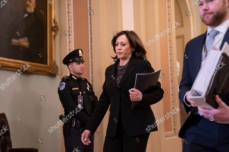 Sen. Kamala Harris, D-Calif., arrives at the Senate for the start of the impeachment trial of President Donald Trump on charges of abuse of power and obstruction of Congress, at the Capitol in Washington