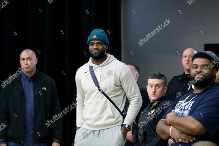 Los Angeles Lakers NBA basketball player LeBron James watches a high school basketball game between his son's team, Sierra Canyon, and Paul VI at the Hoophall Classic in Springfield, Mass