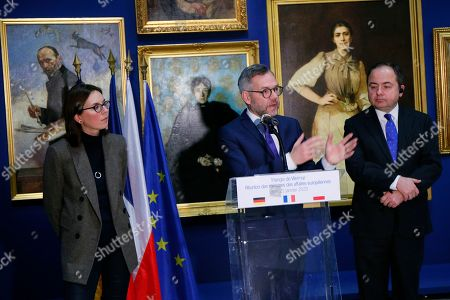 French junior minister for European Affairs Amelie de Montchalin, left, listens to her German counterpart Michael Roth while her Polish counterpart Konrad Szymanski, right, looks, during a press conference after a meeting of the Weimar Triangle at European Affairs level, at the Lens louvre museum in Lens, northern France