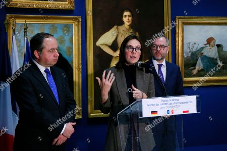 French junior minister for European Affairs Amelie de Montchalin, center, speaks while her German counterpart Michael Roth, right, and her Polish counterpart Konrad Szymanski look, during a press conference after a meeting of the Weimar Triangle at European Affairs level, at the Lens louvre museum in Lens, northern France