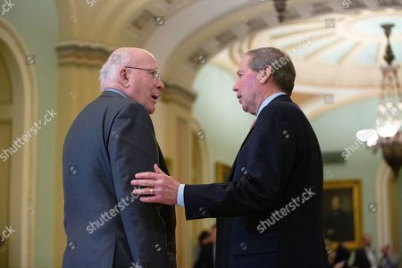 United States Senator Tom Udall (Democrat of New Mexico) speaks to United States Senator Patrick Leahy (Democrat of Vermont) during the first recess of the Senate impeachment trial against President Trump at the United States Capitol.