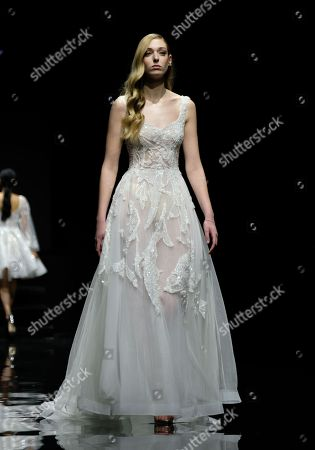 A model on the catwalk wearing a design by Abed Mahfouz