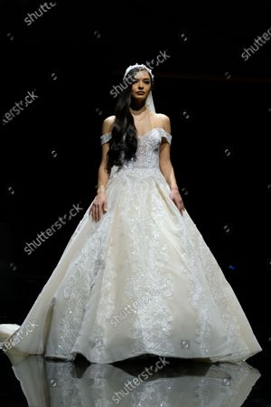 Stock Photo of A model on the catwalk wearing a design by Abed Mahfouz