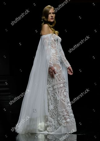 Stock Picture of A model on the catwalk wearing a design by Abed Mahfouz