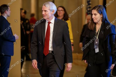 Republican Senator from Ohio Robert Portman walks into a Senate Republican policy luncheon in the US Capitol in Washington, DC, USA, 21 January 2020. The first full day of the Senate impeachment trial of US President Donald J. Trump will be spent debating the rules for the proceedings with Senate Majority Leader Mitch McConnell pushing for two12 hour days for each side to present their opening remarks.