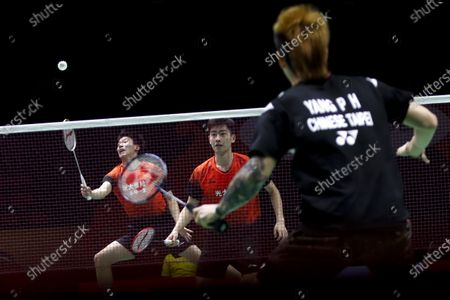 China's Di Zi Jian (L) and Wang Chang in action during their men's doubles match against Taipei's Lu Ching Yao and Yang Po Han on day 1 of the Badminton Princess Sirivannavari Thailand Masters 2020 in Bangkok, Thailand, 21 January 2020. The Princess Sirivannavari Thailand Masters 2020 runs from 21 to 26 January 2020.