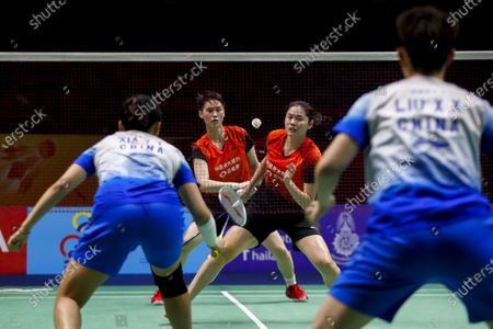 Stock Photo of China's Zheng Yu (C R) and Li Wen Mei in action against China's Liu Xuan Xuan and Xia Yu Ting (L) during their women's doubles match on day 1 of the Badminton Princess Sirivannavari Thailand Masters 2020 in Bangkok, Thailand, 21 January 2020. The Princess Sirivannavari Thailand Masters 2020 runs from 21 to 26 January 2020.