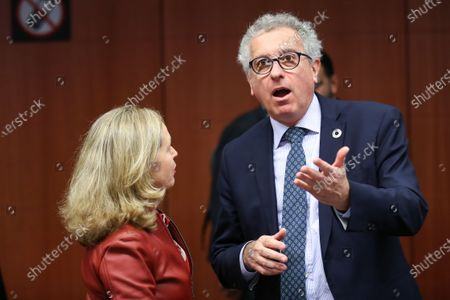 Luxembourg's Finance Minister Pierre Gramegna (R) talks with Spanish Economy Minister Nadia Calvino before an Eurogroup finance ministers' meeting