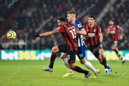Callum Wilson (13) of AFC Bournemouth battles for possession with Adam Webster (15) of Brighton and Hove Albion during the Premier League match between Bournemouth and Brighton and Hove Albion at the Vitality Stadium, Bournemouth
