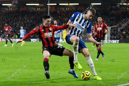 Harry Wilson (22) of AFC Bournemouth battles for possession with Adam Webster (15) of Brighton and Hove Albion during the Premier League match between Bournemouth and Brighton and Hove Albion at the Vitality Stadium, Bournemouth