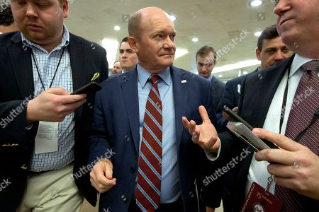 Sen. Chris Coons, D-Del., talks to reporters on Capitol Hill in Washington, . President Donald Trump's impeachment trial quickly burst into a partisan fight Tuesday as proceedings began unfolding at the Capitol. Democrats objected strongly to rules proposed by the Republican leader for compressed arguments and a speedy trial