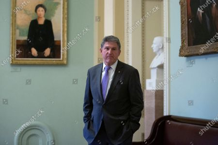 United States Senator Joe Manchin III (Democrat of West Virginia) stands in the Ohio Clock Corridor at the United States Capitol during a recess of the United States Senate