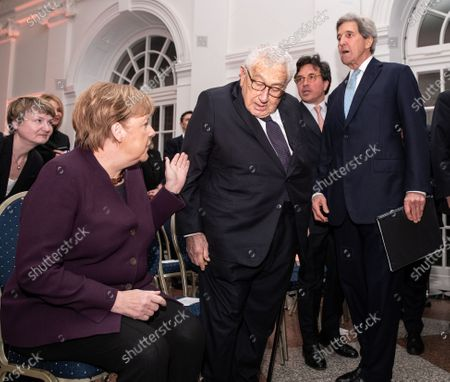 (L-R) German Chancellor Angela Merkel, former U.S State Secretary Henry Kissinger and former U.S. Secretary of State John Kerry arrive for the Henry Kissinger Prize event at the Great Orangery at Charlottenburg Palace in Berlin, Germany, 21 January 2020. The Henry Kissinger Prize is awarded by the American Academy in Berlin for exceptional contributions to transatlantic relations.