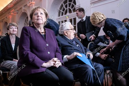(L-R) German Chancellor Angela Merkel and  former U.S State Secretary Henry Kissinger, arrive for the Henry Kissinger Prize event at the Great Orangery at Charlottenburg Palace in Berlin, Germany, 21 January 2020. The Henry Kissinger Prize is awarded by the American Academy in Berlin for exceptional contributions to transatlantic relations.