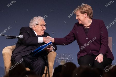 Former U.S State Secretery Henry Kissinger (L) and German Chancellor Angela Merkel (R) shake hands before she will be  awarded with the Henry Kissinger prize at the Great Orangery at Charlottenburg Palace in Berlin, Germany, 21 January 2020. The Henry Kissinger Prize is awarded by the American Academy in Berlin for exceptional contributions to transatlantic relations.