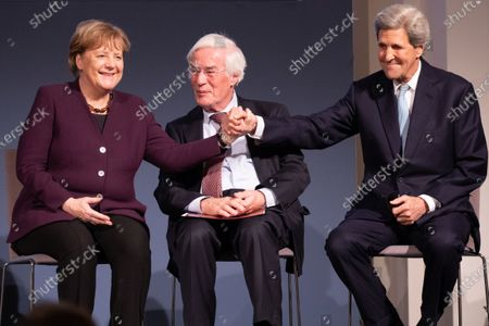 German Chancellor Angela Merkel (L) holds hands with former United States Secretary of State John Kerry (R) as American Academy Trustee Gerhard Casper (C) looks on during the Henry Kissinger Prize event at the Great Orangery at Charlottenburg Palace in Berlin, Germany, 21 January 2020. The Henry Kissinger Prize is awarded by the American Academy in Berlin for exceptional contributions to transatlantic relations.