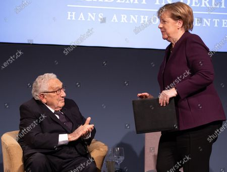 Former U.S State Secretery Henry Kissinger (L) applaudes as German Chancellor Angela Merkel (R) makes her way to deliver a speech after being awarded the Henry Kissinger prize at the Great Orangery at Charlottenburg Palace in Berlin, Germany, 21 January 2020. The Henry Kissinger Prize is awarded by the American Academy in Berlin for exceptional contributions to transatlantic relations.