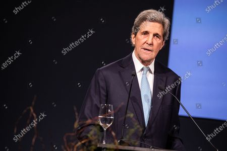 Former U.S. Secretary of State John Kerry delivers a speech during an event in which German Chancellor Merkel is awarded the Henry Kissinger Prize at the Great Orangery at Charlottenburg Palace in Berlin, Germany, 21 January 2020. The Henry Kissinger Prize is awarded by the American Academy in Berlin for exceptional contributions to transatlantic relations.