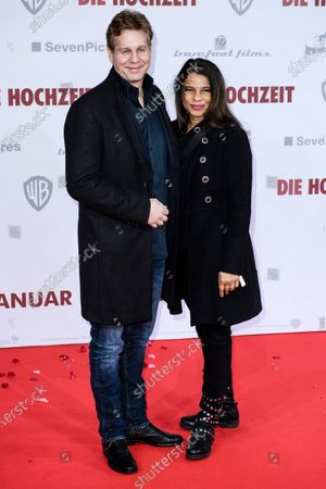 Thomas Heinze (L) and partner Jackie Brown pose on the red carpet of the film premiere for 'Die Hochzeit' (lit.: The Wedding) at the Zoo Palast cinema in Berlin, Germany, 21 January 2020. The movie will be screened German cinemas from 23 January 2020.