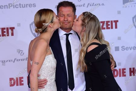 Til Schweiger (C) receives kisses by his daughters, German actress Lilli Schweiger (R) and German actress Luna Schweiger (L), during the red carpet of the film premiere for 'Die Hochzeit' (lit.: The Wedding) at the Zoo Palast cinema in Berlin, Germany, 21 January 2020. The movie will be screened German cinemas from 23 January 2020.