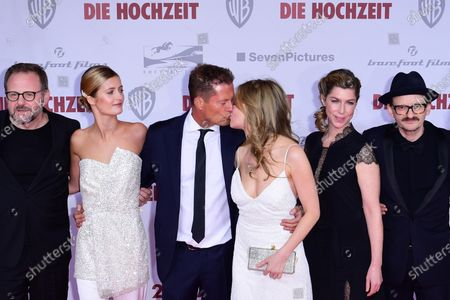 Til Schweiger (3-L) and German actress Stefanie Stappenbeck (4-L) kiss next to Bugarian-German actor Samuel Finzi (L), German actress Lilli Schweiger (2-L), German actress Brigitte Zeh (5-L) and German actor Milan Peschel (R) as they pose on the red carpet of the film premiere for 'Die Hochzeit' (lit.: The Wedding) at the Zoo Palast cinema in Berlin, Germany, 21 January 2020. The movie will be screened German cinemas from 23 January 2020.