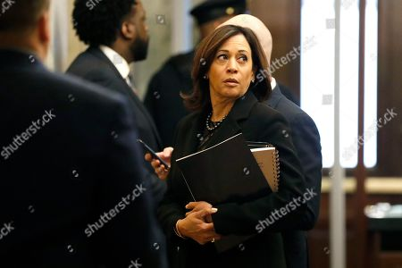 Sen. Kamala Harris, D-Calif., waits for an elevator while arriving at the Capitol in Washington,. President Donald Trump's impeachment trial quickly burst into a partisan fight Tuesday as proceedings began unfolding at the Capitol. Democrats objected strongly to rules proposed by the Republican leader for compressed arguments and a speedy trial