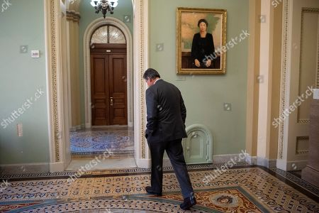 Sen. Joe Manchin, D-W.Va., walks away from the Senate chamber at the Capitol in Washington,. President Donald Trump's impeachment trial quickly burst into a partisan fight Tuesday as proceedings began unfolding at the Capitol