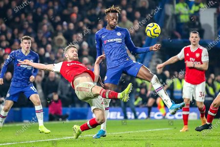 Arsenal defender Shkodran Mustafi (20) clears the ball away from Chelsea forward Tammy Abraham (9) during the Premier League match between Chelsea and Arsenal at Stamford Bridge, London