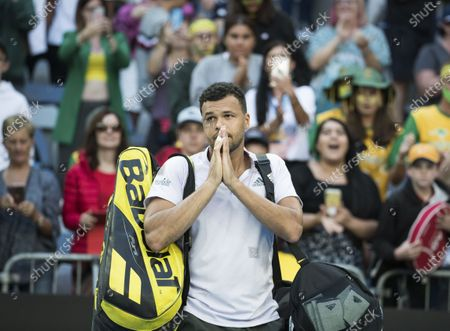 Jo-Wilfried Tsonga gestures after retiring from men's first round match
