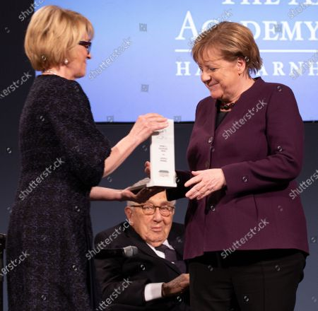 American Academy Chairwoman Gahl Burt (L) presents the Henry A. Kissinger Priza to  German Chancellor Angela Merkel (R) as former U.S State Secretary Henry A. Kissinger watches (C) at the Great Orangery at Charlottenburg Palace in Berlin, Germany, 21 January 2020. The Henry A. Kissinger Prize is awarded by the American Academy in Berlin for exceptional contributions to transatlantic relations.