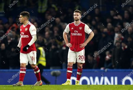 Dejected Arsenal defender Shkodran Mustafi (C) after going 0-1 down and having a teammate sent off during the English Premier League match between Chelsea and Arsenal in London, Britain, 21 January 2020.
