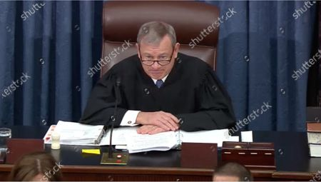 In this image from United States Senate television, Chief Justice of the United States John G Roberts Jnr, Jr. presides as the US Senate considers an amendment to US Senate Resolution 483