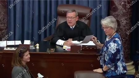 In this image from United States Senate television, Chief Justice of the United States John G Roberts Jnr, Jr. reads the final vote tally on US Senate Resolution 483, during the impeachment trial of US President Donald J. Trump in the US Senate in the US Capitol in Washington, DC early in the morning of. Mandatory