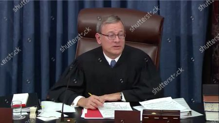 In this image from United States Senate television, Chief Justice of the United States John G Roberts Jnr, Jr. presides as US Senate Resolution 483 is debated during the impeachment trial of US President Donald J. Trump in the US Senate in the US Capitol