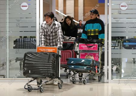 Song Kang-ho (front) and other cast members of 'Parasite' arrive at Incheon International Airport, west of Seoul, South Korea, 22 January 2020, after winning the SAG Award for Outstanding Performance in this year's Screen Actors Guild (SAG) Awards in the United States.