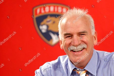 Florida Panthers head coach and former Chicago Blackhawks coach, Joel Quenneville, smiles as he talks with reporters during his first visit back to Chicago as a head coach before an NHL hockey game between the Blackhawks and Panthers, in Chicago