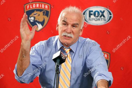 Florida Panthers head coach and former Chicago Blackhawks coach, Joel Quenneville, responds to a question during his first visit back to Chicago as a head coach before an NHL hockey game between the Blackhawks and Panthers, in Chicago
