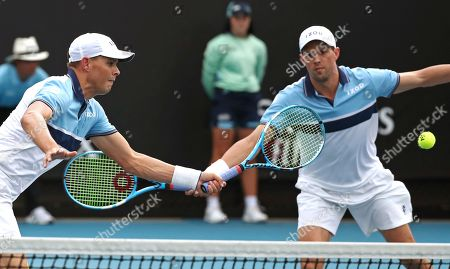 Bob, left, and Mike Bryan of the U.S. during their first round doubles match against India's Rohan Bopanna and Japan's Yasutaka Uchiyama at the Australian Open tennis championship in Melbourne, Australia