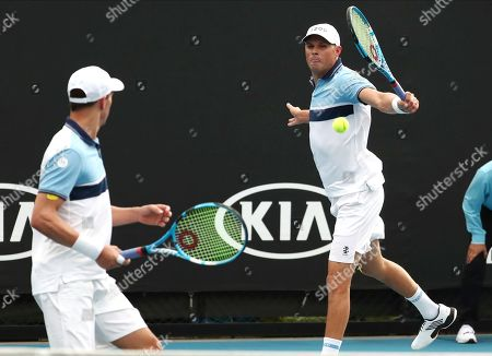 Bob, right, and Mike Bryan of the U.S. during their first round doubles match against India's Rohan Bopanna and Japan's Yasutaka Uchiyama at the Australian Open tennis championship in Melbourne, Australia