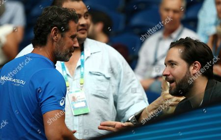 Serena Williams' husband Alexis Ohanian, right, chats with her coach Patrick Mouratoglou ahead of her second round singles match against Slovenia's Tamara Zidansek at the Australian Open tennis championship in Melbourne, Australia
