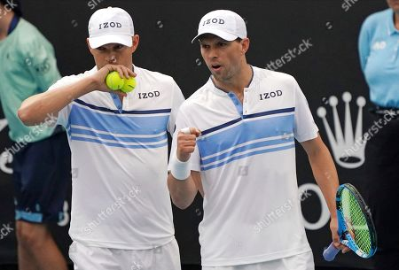Stock Photo of Bob, left, and Mike Bryan of the U.S. talk during their first round doubles match against India's Rohan Bopanna and Japan's Yasutaka Uchiyama at the Australian Open tennis championship in Melbourne, Australia