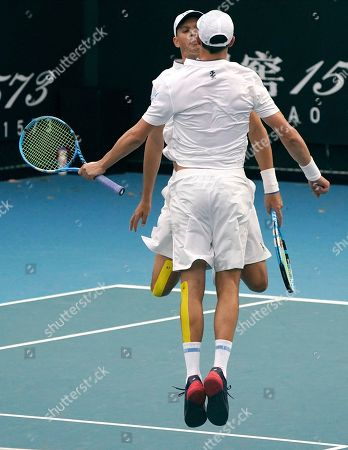 Stock Picture of Bob, left, and Mike Bryan of the U.S. celebrate their their first round doubles win over India's Rohan Bopanna and Japan's Yasutaka Uchiyama at the Australian Open tennis championship in Melbourne, Australia