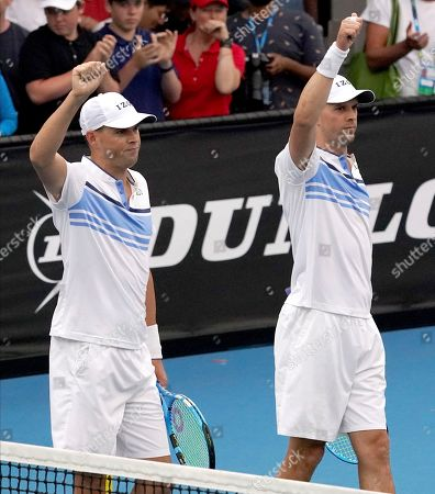 Bob, left, and Mike Bryan of the U.S. gesture to the crowd after their first round doubles win over India's Rohan Bopanna and Japan's Yasutaka Uchiyama at the Australian Open tennis championship in Melbourne, Australia