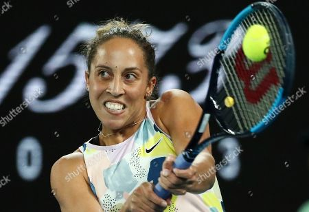 Madison Keys of the U.S. makes a backhand return to Arantxa Rus of the Netherlands during their second round singles match at the Australian Open tennis championship in Melbourne, Australia