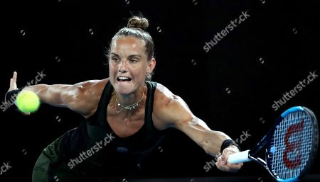 Arantxa Rus of the Netherlands makes a forehand return to Madison Keys of the U.S. during their second round singles match at the Australian Open tennis championship in Melbourne, Australia