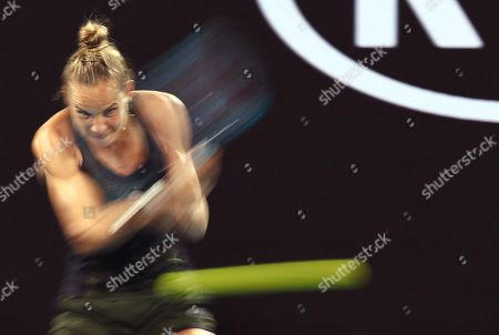 Stock Photo of Arantxa Rus of the Netherlands makes a backhand return to Madison Keys of the U.S. during their second round singles match at the Australian Open tennis championship in Melbourne, Australia