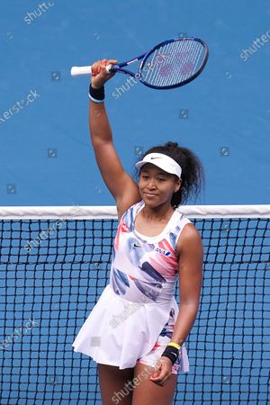 Naomi Osaka of Japan celebrates after defeating Saisai Zheng of China during their second round match at the Australian Open tennis tournament at Melbourne Park in Melbourne, Australia, 22 January 2020.