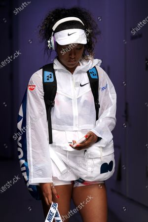 Stock Photo of Naomi Osaka of Japan arrives on court ahead of her second round match against Saisai Zheng of China on day three of the Australian Open tennis tournament at Melbourne Park in Melbourne, Australia, 22 January 2020.