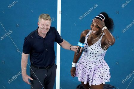 Serena Williams of the USA (R) is interviewed by former tennis player Jim Courier after winning her second round match against Tamara Zidansek of Slovenia on day three of the Australian Open tennis tournament at Rod Laver Arena in Melbourne, Australia, 22 January 2020.