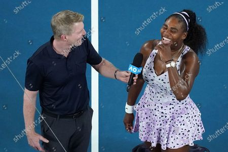 Stock Photo of Serena Williams of the USA (R) is interviewed by former tennis player Jim Courier after winning her second round match against Tamara Zidansek of Slovenia on day three of the Australian Open tennis tournament at Rod Laver Arena in Melbourne, Australia, 22 January 2020.